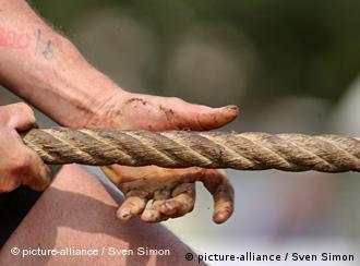 Pair of hands grabbing a rope in a tug-of-war