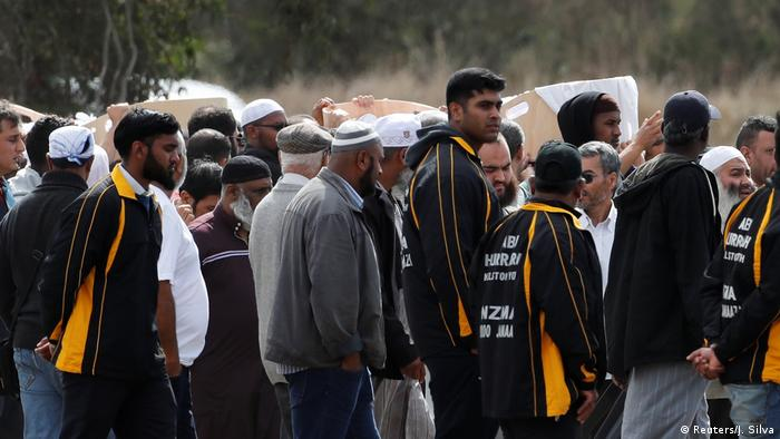 Mourners gather for a burial ceremony