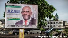 A campaign billboard of incumbent Comoros President Azali Assoumani in the capital, Moroni.