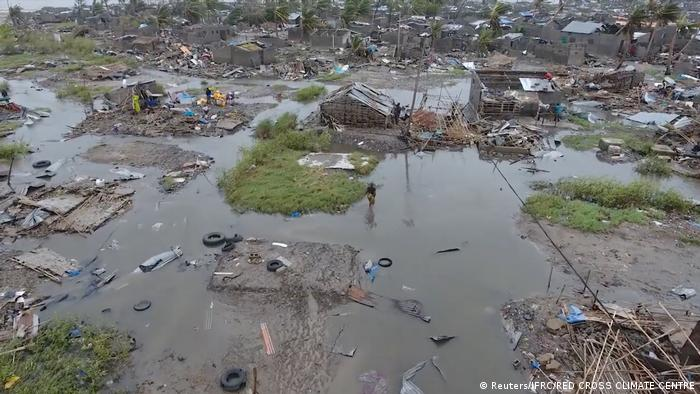 An aeriel view of the coastal city of Beira after the cyclone passed through. Debris is scattered everywhere and only a couple of structures remain standing in the floodwaters.