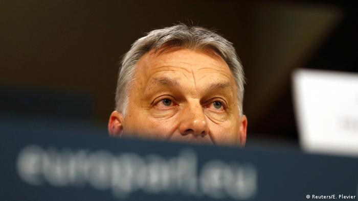 Viktor Orban at a table (Reuters/E. Plevier)
