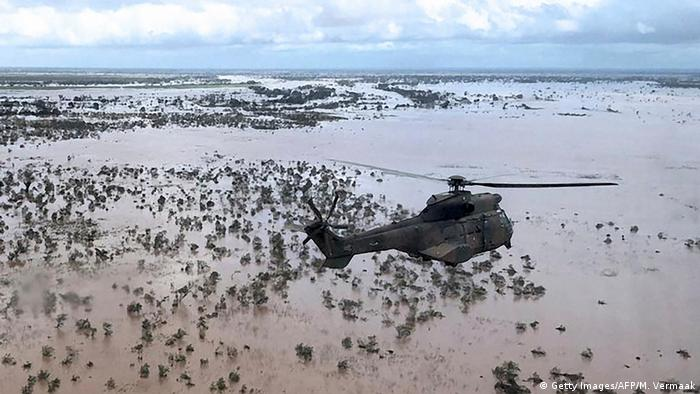 An Oryx helicopter from the SANDF (South African National Defence Forces) flies during an air relief drop mission over the flooded area around Beira, central Mozambique, on March 20, 2019