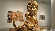 BONN, GERMANY - MARCH 21: A sculpture with the title 'Michael Jackson and Bubbles' (Gold) by the American artist Paul McCarthy is pictured during the preview of the exhibition Michael Jackson - On the Wall at Bundeskunsthalle on March 21, 2019 in Bonn, Germany. The exhibition will be open from March 22nd till July 14, 2019. (Photo by Andreas Rentz/Getty Images)