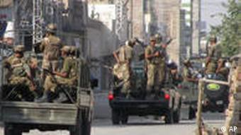 Pakistan Army troops prepare to leave for patrolling