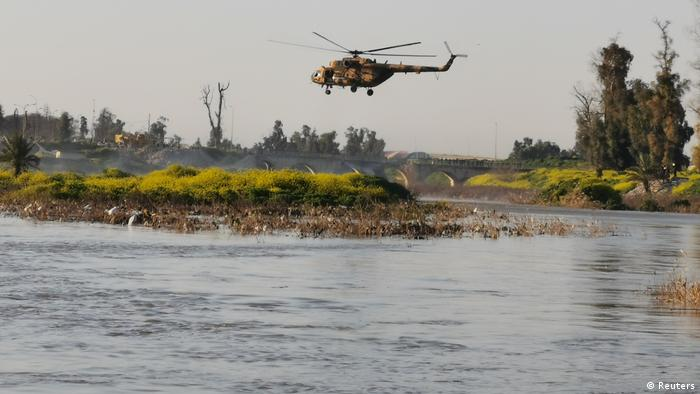 Rescue helicopter scans the Tigris for survivors after ferry boat sinks