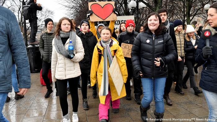 Greta Thunberg and her sister participate in a demonstration in Stockholm