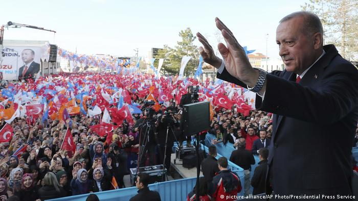 Turkey's President Recep Tayyip Erdogan salutes the supporters of his ruling Justice and Development Party during a rally in Kutahya, Turkey