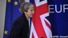 British Prime Minister Theresa May walks to stage on March 21, 2019, on the first day of an EU summit focused on Brexit, in Brussels. - European Union leaders meet in Brussels on March 21 and 22, for the last EU summit before Britain's scheduled exit of the union. (Photo by EMMANUEL DUNAND / AFP)