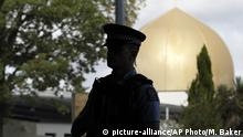 Armed police guard the Al Door mosque ahead of Friday prayers at Hagley Park in Christchurch, New Zealand, Friday, March 22, 2019. In a day without precedent in New Zealand, people across the country were planning to observe the Muslim call to prayer as the nation reflected on the moment one week ago when 50 people were slaughtered at two mosques. (AP Photo/Mark Baker) |