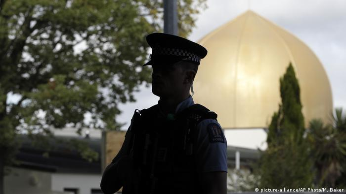 Police officer stands in front of a Christchurch mosque