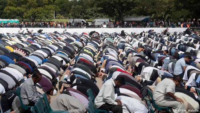 Muslim men pray during a service for the victims of the Christchurch terror attack