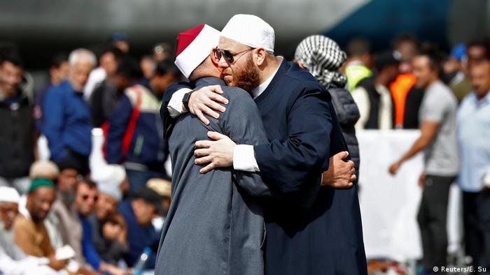 Two men hug at a service for the victims of the Christchurch terror attack