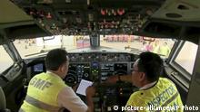 In this image from video taken on Tuesday, March 12, 2019, officials make inspection inside the cockpit of a Boeing 737 Max 8 aircraft is in hangar at Garuda Maintenance Facility at Soekarno Hatta airport, Jakarta. The Indonesian Transport Ministry on Tuesday conducted inspections of 737 Max 8 aircraft owned by Garuda Indonesia and Lion Air. (AP Photo) |