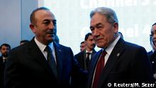 Turkish Foreign Minister Mevlut Cavusoglu shakes hands with New Zealand's Foreign Minister Winston Peters during an emergency meeting of the Organisation of Islamic Cooperation (OIC) in Istanbul, Turkey, March 22, 2019. REUTERS/Murad Sezer