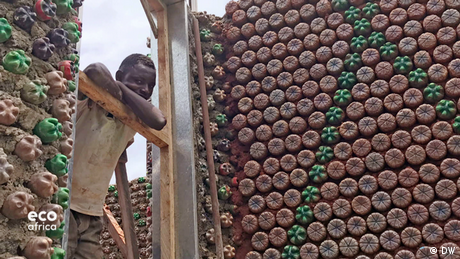 DW Eco Africa - Houses made from bottles in Nigeria