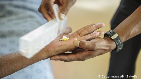 A patient receiving pills against tuberculosis