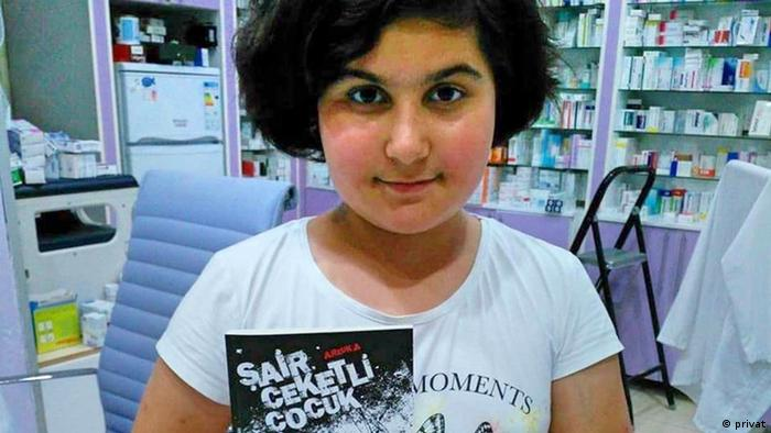 Rabia Naz Vatan holds up a book