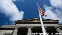 The American flag flies outside the US Department of Justice March 22, 2019 in Washington, DC. - US President Donald Trump went on air Friday to double down on his attempt to discredit a massive probe into his campaign's links to Russia, which is expected to be released shortly. Ever since the investigation run by independent prosecutor and former FBI director Robert Mueller began nearly two years ago Trump has insisted that it is a witch hunt and a hoax. (Photo by Brendan Smialowski / AFP) (Photo credit should read BRENDAN SMIALOWSKI/AFP/Getty Images)