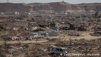 Εικόνα από το κατεστραμμένο Μπαγκούς μετά την στρατιωτική ήττα του Ισλαμικού Κράτους