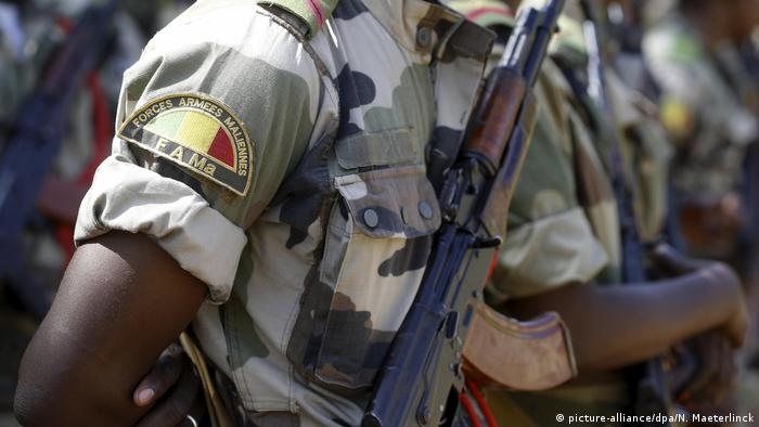 Malian soldiers with guns