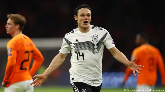 Nico Schulz of Germany celebrates after scoring his team's third goal during the 2020 UEFA European Championships Group C qualifying match between Netherlands and Germany at Johan Cruyff Arena on March 24, 2019 in Amsterdam, Netherlands. z (Getty Images/D. Mouhtaropoulos)