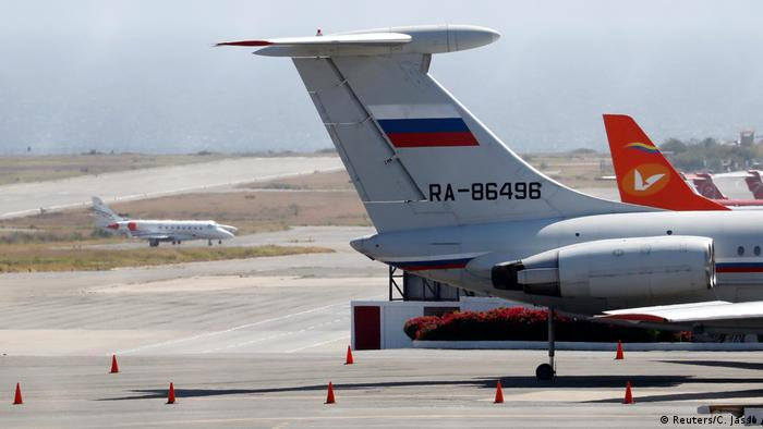An airplane with the Russian flag is seen at Simon Bolivar International Airport in Caracas on March 24 (REUTERS)