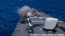 March 10, 2019 - Philippine Sea - The guided missile destroyer USS Curtis Wilbur fires a Mark 45 5-inch gun during a live-fire exercise in the Philippine Sea, March 10, 2019 |
