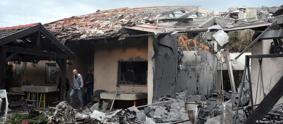 A damaged house that was hit by a rocket