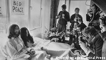 25th March 1969: Beatles singer, songwriter and guitarist John Lennon and his wife of a week Yoko Ono receive the press at their bedside in the Presidential Suite of the Hilton Hotel, Amsterdam. The couple stayed in bed for seven days 'as a protest against war and violence in the world'. (Photo by Central Press/Getty Images)