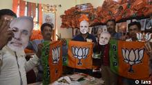 Ranchi: BJP workers holding party flags and Narendra Modi masks gear up for election campaign ahead of 2019 Lok Sabha polls in Ranchi on March 17, 2019. (Photo: IANS)