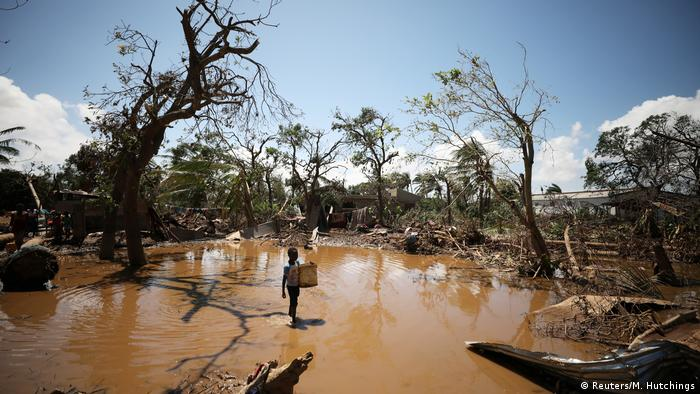 A child walks past debris in flood waters in the aftermath of cyclone Idai in Mozambique