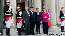 French President Emmanuel Macron, Chinese President Xi Jinping, German Chancellor Angela Merkel and European Commission President Jean-Claude Juncker pose before a meeting at the Elysee Palace in Paris, France, March 26, 2019. REUTERS/Philippe Wojazer