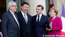 French President Emmanuel Macron, Chinese President Xi Jinping, German Chancellor Angela Merkel and European Commission President Jean-Claude Juncker pose before a meeting at the Elysee Palace (Reuters/P. Wojazer)