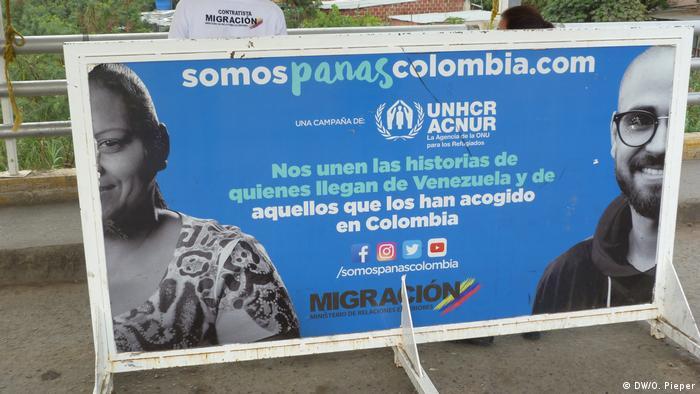 Cartel sobre migración venezolana en Colombia.