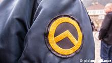 """September 29, 2018 - Garmisch Partenkirchen, Bavaria, Germany - Logo of the Identitaere Bewegung worn by a person that appeared to be working in a security capacity at the Compact Konferenz in Garmisch Partenkirchen. Adding themselves to the """"who's who"""" list of of several hundred right-extremists from Germany, Austria, Switzerland, and other countries, Tommy Robinson, founder of the British EDL, Lutz Bachmann, grounder of Germany's Pegida, and Martin Sellner of the Identitaere Bewegung were guests as the Compact Konferenz held in the international tourist town of Garmisch Partenkirchen in southern Bavaria. The conferences are held by Juergen Elsaesser, founder of Compact magazine, a publication designed for right-extremists, conspiracy theorists, and right-wing sovereign citizens (Reichsbuerger). The venue was the ironically-named Gasthof zum Rassen, which residents state has hosted numerous, unwanted far-right and right-extreme events in the village. The city government is furthermore relatively quiet about such events, as stated by residents """"they are afraid tourists will find out"""". Despite this, a spontaneous demonstration by residents took place 