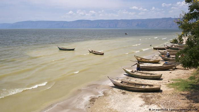 Wooden boats lined up on the shores of Lake Albert in Uganda