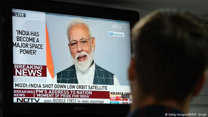 Indian Prime Minister Narendra Modi seen on a TV screen talking about his country's anti-satellite rocket capabilities (Getty Images/AFP/P. Singh)
