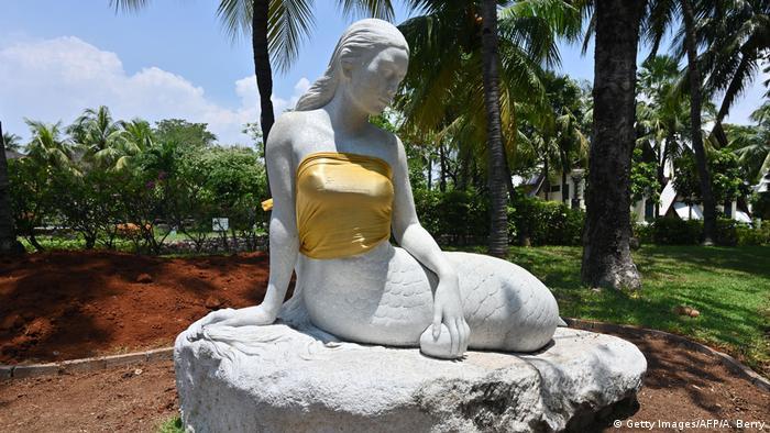 Indonesia debates nudity after resort 'fixes' topless mermaid statues