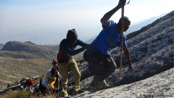 Former prisoners with the Nkhokwe Arts theater company climb Sapitwa, Malawi's highest peak