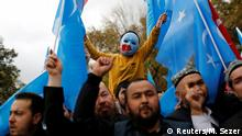 A masked Uighur boy takes part in a protest against China, at the courtyard of Fatih Mosque, a common meeting place for pro-Islamist demonstrators in Istanbul, Turkey, November 6, 2018. REUTERS/Murad Sezer SEARCH SEZER NOURMUHAMMED FOR THIS STORY. SEARCH WIDER IMAGE FOR ALL STORIES. TPX IMAGES OF THE DAY.