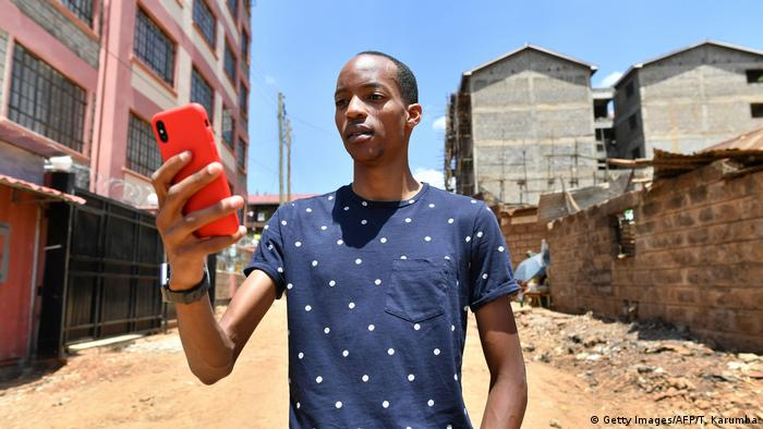 Man holding a cellphone (Tony Karumba/AFP/Getty Images)