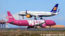 A WOW Air Airbus A321 and an Icelandair Boeing 757-200, captured in the same image on the runway at an airport in Iceland. Archive image from 2017. (imago/Aviation-Stock)