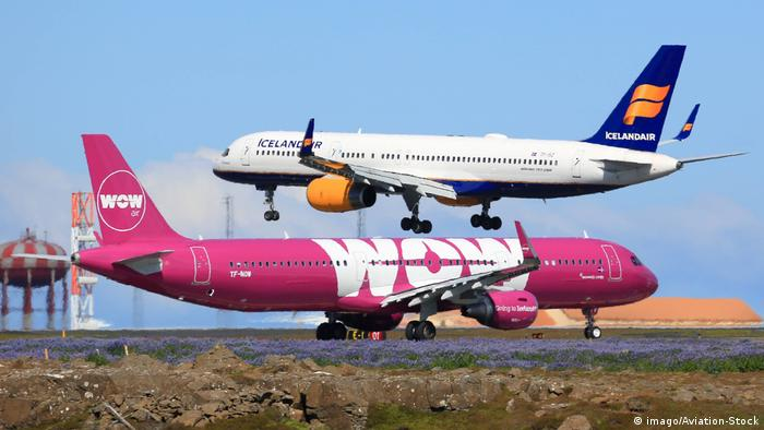 A WOW Air Airbus A321 and an Icelandair Boeing 757-200, captured in the same image on the runway at an airport in Iceland. Archive image from 2017.