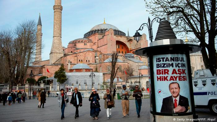 People walk past an Erdogan election poster outside Hagia Sophia (Getty Images/AFP/Y. Akgul)