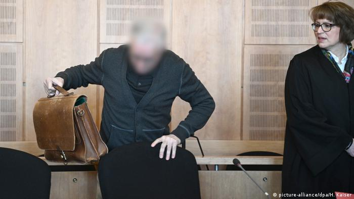 Courtroom with blurred picture of accused