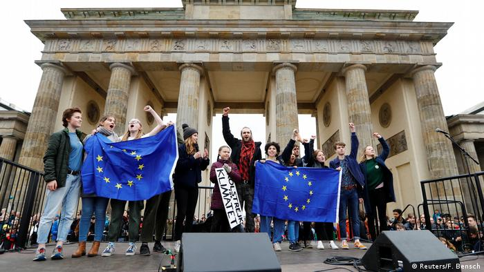 Greta Thunberg and young environmental activists demonstrate with EU flags on March 29 outside the Brandenburg Gate in Berlin.