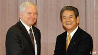Japan's Defense Minister Kitazawa shakes hands with US Secretary of Defense Robert Gates