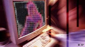 Man at computer with dithered image of person on screen