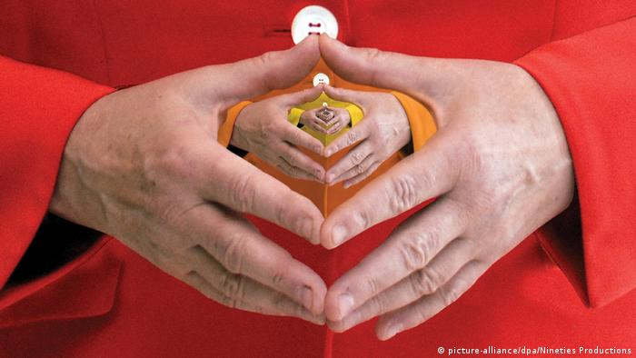 Merkel's hands held in her signature 'diamond shape'