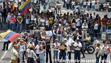 Opposition supporters demonstrate against Venezuelan President Nicolas Maduro in Caracas, on March 30, 2019. - Living conditions are plummeting in the oil-producing Latin American nation, which is spiralling ever deeper into economic chaos during a protracted political crisis. (Photo by Yuri CORTEZ / AFP) (Photo credit should read YURI CORTEZ/AFP/Getty Images)